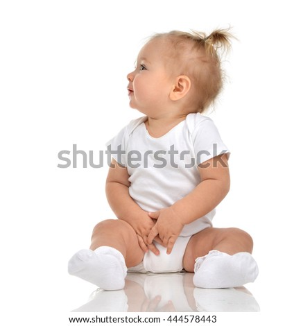 Infant child baby girl in diaper sitting happy looking at the corner isolated on a white background - stock photo