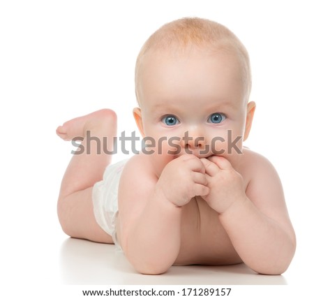 Infant child baby girl lying with hands in the mouth on a white background - stock photo