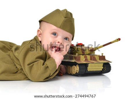 Infant child baby toddler lying in green military soldier uniform with St Georges ribbon flag and small tank on a white background 70 years of victory in World War II - stock photo