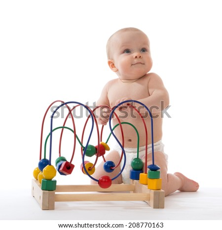 Infant child baby toddler standing and playing wooden educational toy with looped wires for teaching coordination on a white background - stock photo