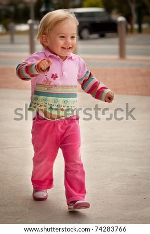 Infant enjoying being outside - stock photo