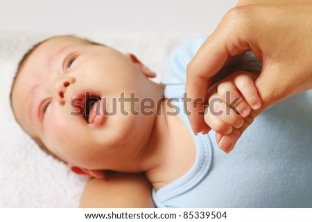Infant in bed isolated - stock photo