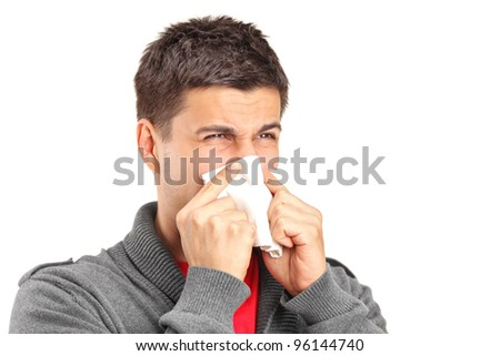 Infected man blowing his nose in tissue paper because of being ill isolated on white background - stock photo