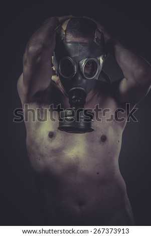 Infection, concept of risk of contamination, naked man with gas mask - stock photo