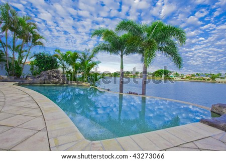Infinity Pool with Views over canal - stock photo