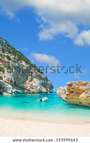 inflatable boat in Cala Mariolu, Sardinia - stock photo