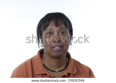 informal portrait of a black middle-aged woman with a pleasant expression looking directly at camera - stock photo