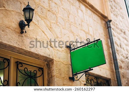 Information boards on the stone wall - stock photo