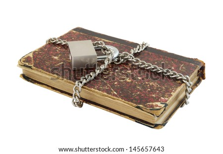 Information security concept, old book with chain and padlock  - stock photo