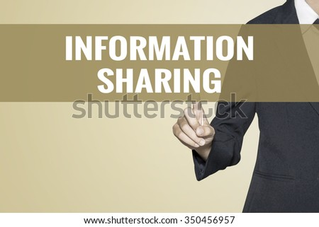 Information Sharing word on vintage background retro virtual screen touch by business woman on white background - stock photo