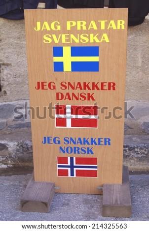 information sign for customers. I speak Swedish, Danish, and Norwegian language. tourism. - stock photo