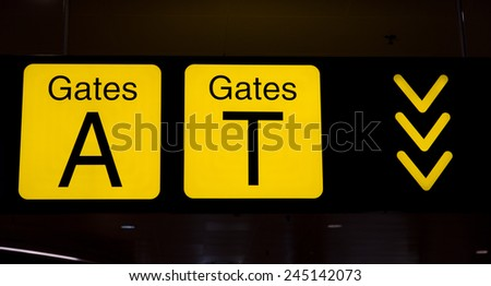 Information sign in an airport departure terminal - stock photo