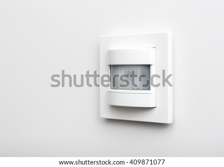 Infrared detector for smart home on the wall - stock photo