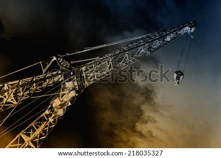 Infrared dramatic image of crane in building industry - stock photo