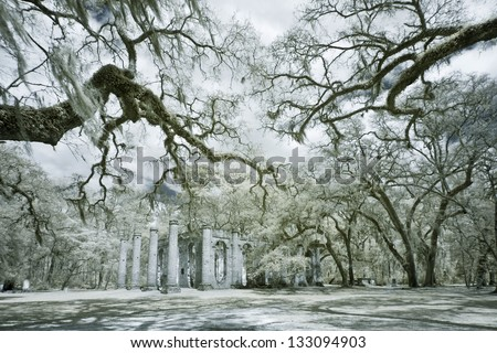 infrared photo of church ruin and live oak trees - stock photo