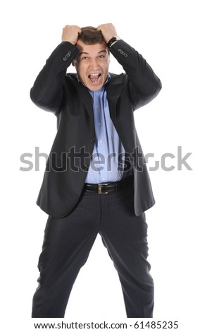 Infuriated businessman holding his head. Isolated on white background - stock photo