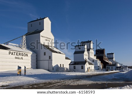 Inglis, Manitoba, Canada. The best remaining example in Canada of a vintage grain elevator row. A national historic site. - stock photo