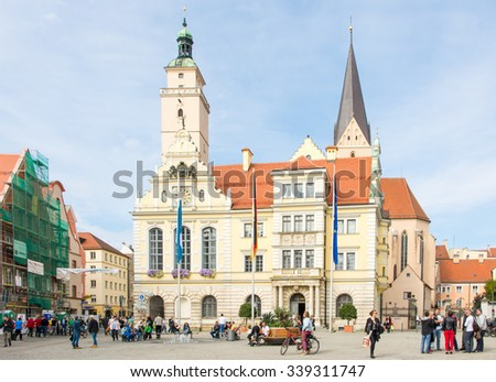 INGOLSTADT, GERMANY - OKTOBER 3: Tourists at the historic town hall of Ingolstadt, Germany on Oktober 3, 2015. Foto taken from Moritzstrasse with view to the town hall. - stock photo