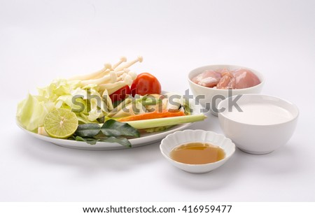 ingredient of Tom Kha Kai, famous Thai spicy coconut soup coconut milk, galangal, kaffir lime leaves, lemongrass, Thai chili peppers, mushrooms, chicken, fish sauce, and lime juice - stock photo