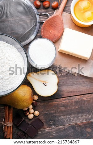 Ingredients and tools for baking sweet cake with chocolate and pears - stock photo