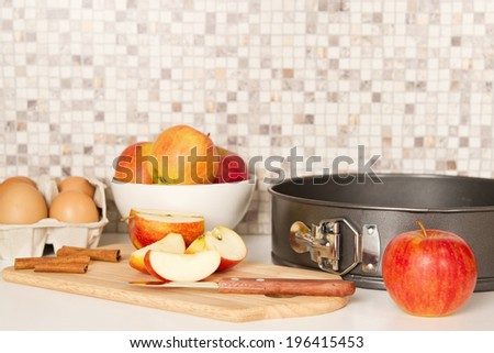 Ingredients and tools to make a apple pie on white kitchen table - stock photo