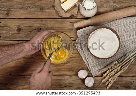 Ingredients for bakery products. Male chef prepares on rustic kitchen. Top view - stock photo