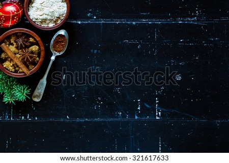 Ingredients for baking cake on dark vintage board. Top view. Christmas background with space for text. - stock photo