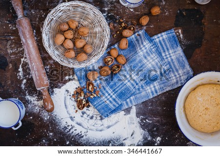 Ingredients for baking cake, roll, strudel, cupcake stuffed with nuts mincemeat. Cooking class buttery yeast nuts and walnuts stuffing dough. See series recipe step on step. - stock photo