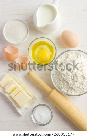 Ingredients for baking on the white wooden table, top view - stock photo