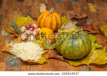 Ingredients for cheese fondue with pepper, chestnut mushrooms, pumpkin and cheese - stock photo