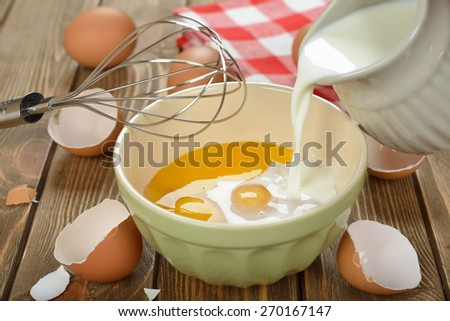Ingredients for cooking omelets on a brown background - stock photo
