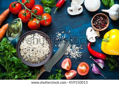 Ingredients for cooking - rice, vegetables and herbs. Top view with copyspace. Organic food background. - stock photo