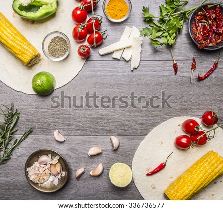 ingredients for cooking vegetarian burritos lined frame, with tomatoes, pepper, spicy chili, corn, cheese and garlic border with space for text  on grey wooden rustic background top view close up - stock photo