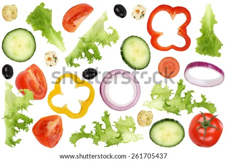 Ingredients for flying salad with tomatoes, Feta cheese, lettuce, onion, olives and cucumber - stock photo