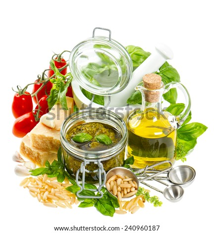 Ingredients for fresh green pesto sauce: olive oil, basil, parmesan, pine nuts, tomato. Healthy food. Organic nutrition - stock photo