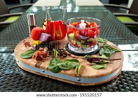 Ingredients for gazpacho cold soup in a blender, still life outdoors - stock photo