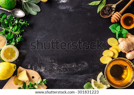 Ingredients for ginger tea with lemon and honey on slate plate - stock photo