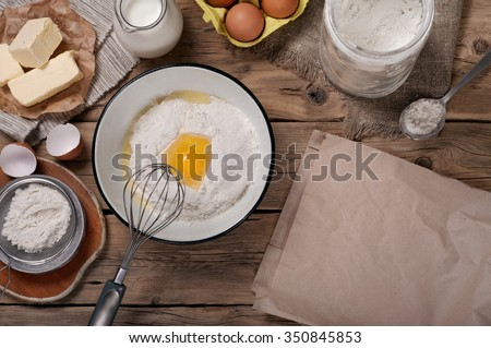 Ingredients for homemade dough (butter, egg, milk , flour). Ingredients for bakery products. Top view. Copy space - stock photo
