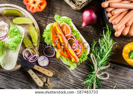 Ingredients for homemade hot dog with fresh vegetable - stock photo