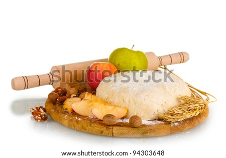 ingredients for homemade pie on wooden plate isolated on white - stock photo