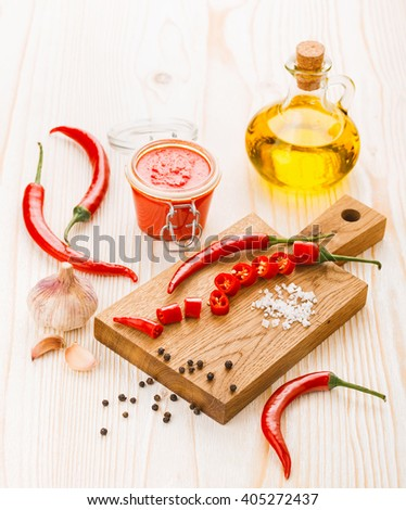Ingredients for hot chili pepper sauce preparation - stock photo