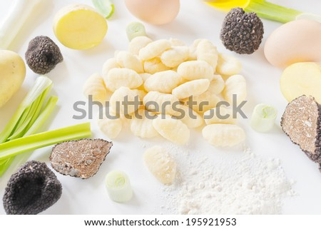 Ingredients for italian gnocchi with black truffle - stock photo