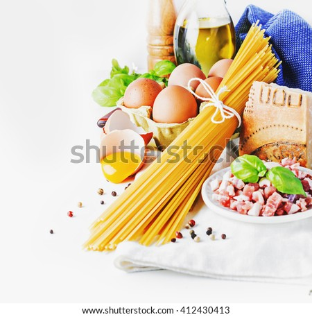 Ingredients for italian pasta alla carbonara  with parmesan and yolk on white table. selective focus. - stock photo
