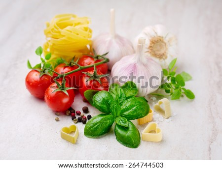Ingredients for Italian pasta, basil, garlic and tomatoes - stock photo