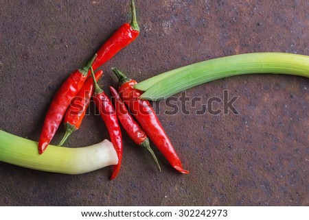 Ingredients for japanese soba stir fry: leek and chili peppers - stock photo