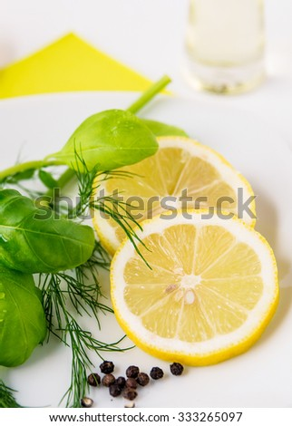 Ingredients for lemon-dill-basil dressing with peppercorns - stock photo