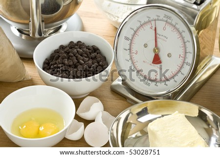 Ingredients for making chocolate chip cookies - stock photo