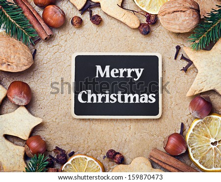Ingredients for making Christmas cookies and holiday greetings - stock photo