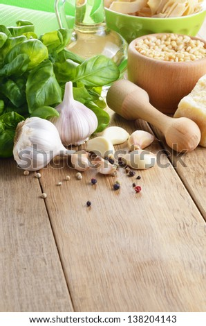 Ingredients for making pesto sauce on the kitchen table - stock photo