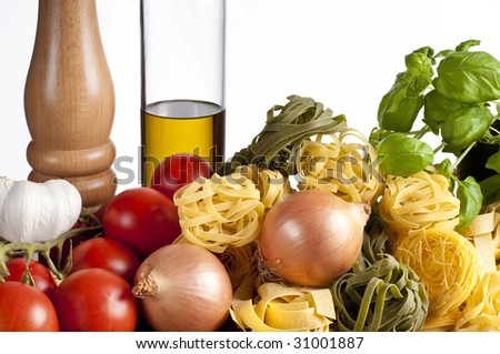 Ingredients for pasta with vegetables in studio with white background - stock photo